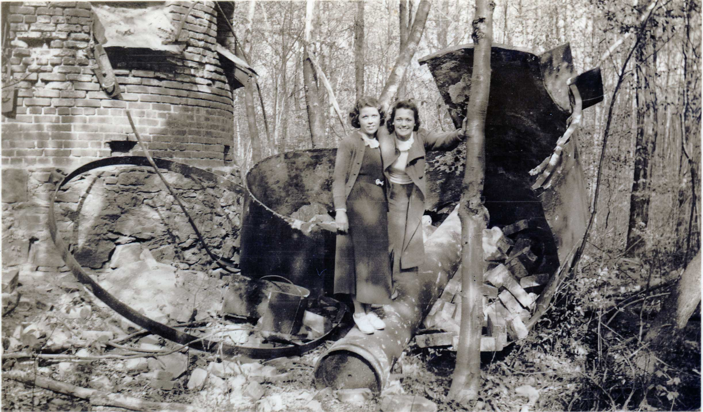 Dorothy Rogallski and Beatrice Wyckoff, 1932, sitting atop an iron roaster in Chester, NJ
